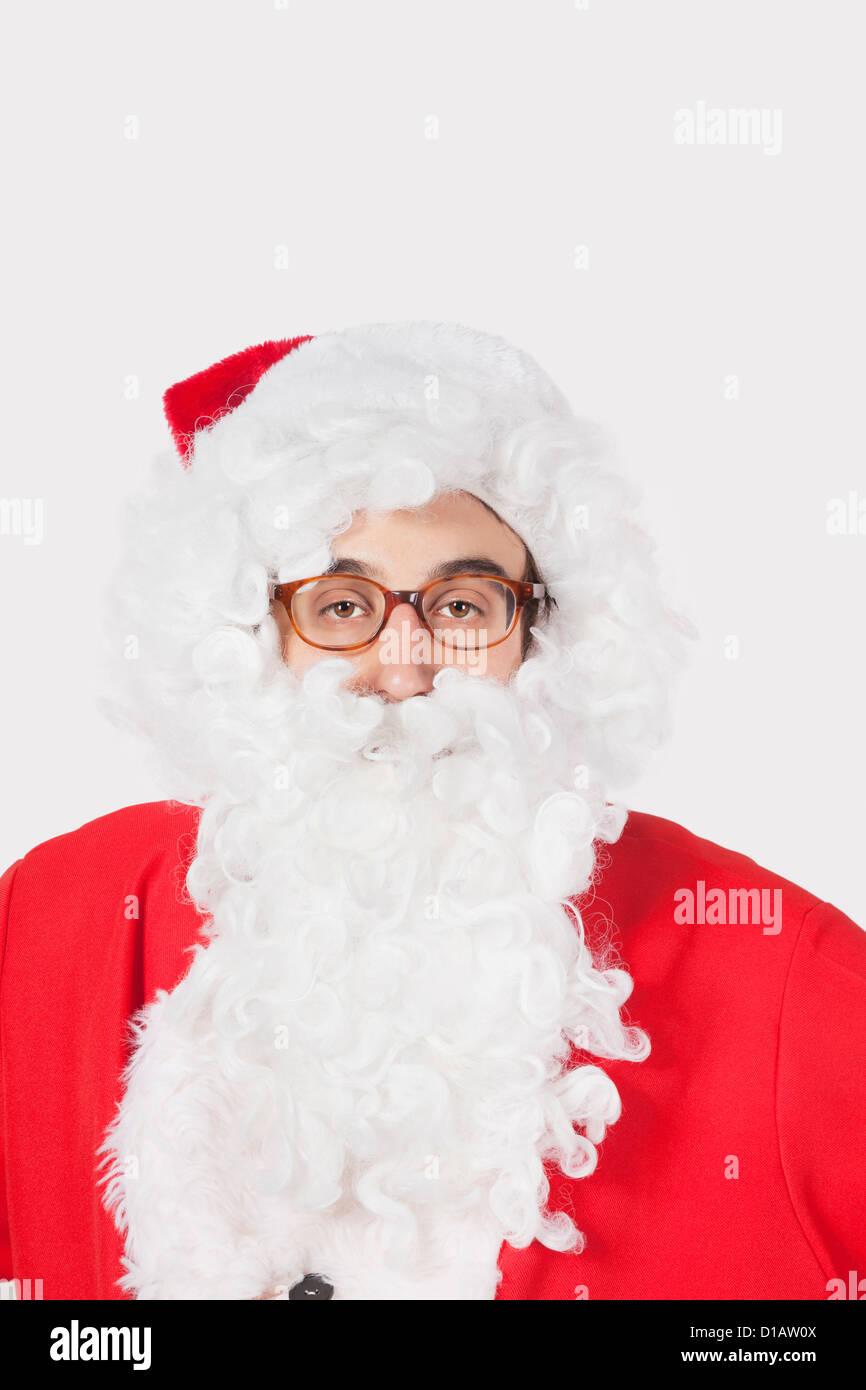 Portrait man in Santa costume - Stock Image