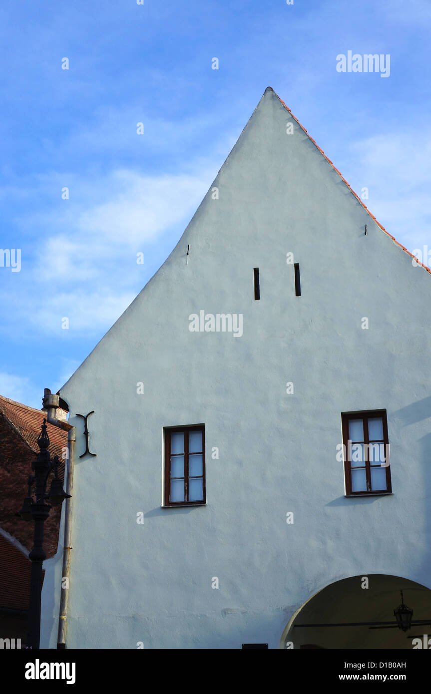 The white facade of the Emil Sigerus Museum of of Saxon Ethnography and Folk Art of Sibiu in Romania - Stock Image