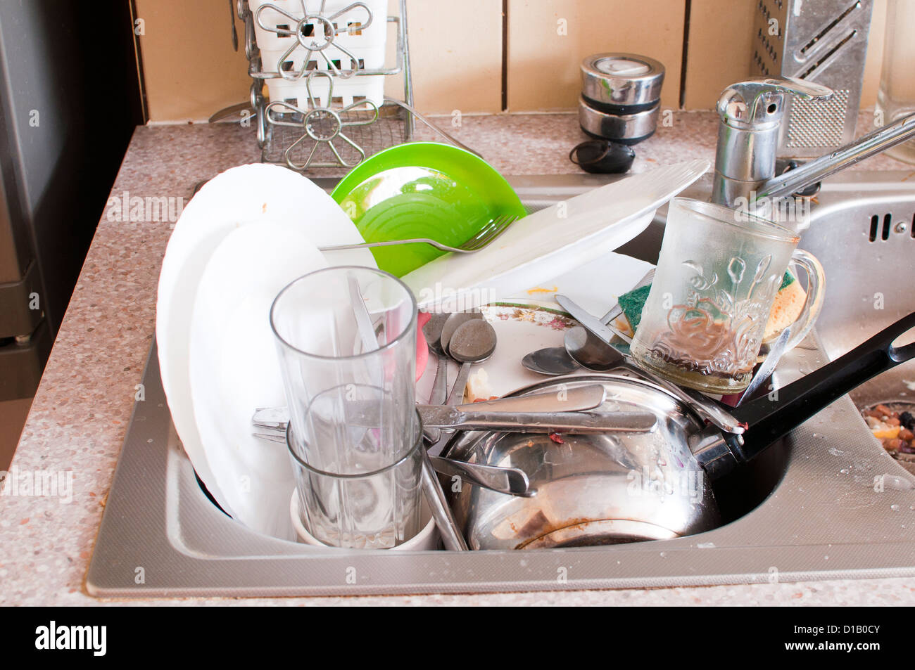 dishes in the sink - mess in the kitchen - Stock Image