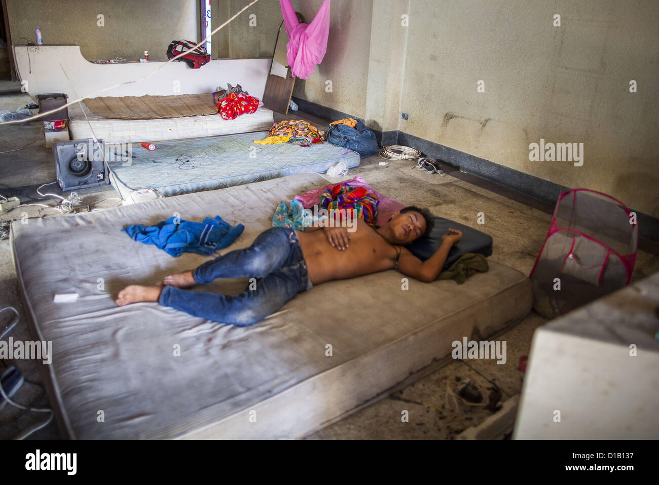 Dec. 13, 2012 - Bangkok, Thailand - A worker naps in the building he and his colleagues are demolishing at ''Washington - Stock Image