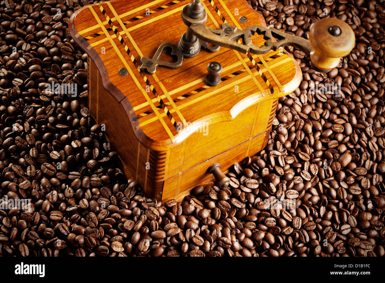 antique coffee mill with coffee beans - Stock Image