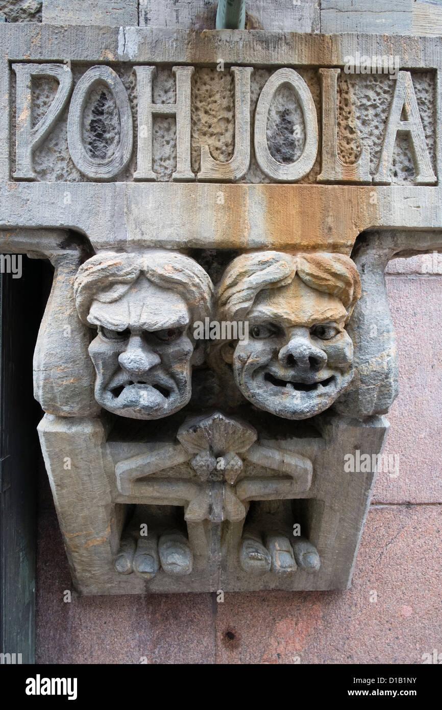 Detail of two gargoyles on office building in Helsinki Finland - Stock Image
