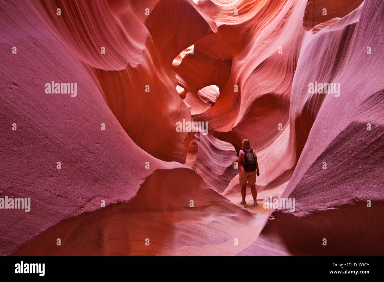 Female Tourist Hiker and Sandstone Rock Formations, Lower Antelope Canyon, Page, Arizona, USA United states of America - Stock Image