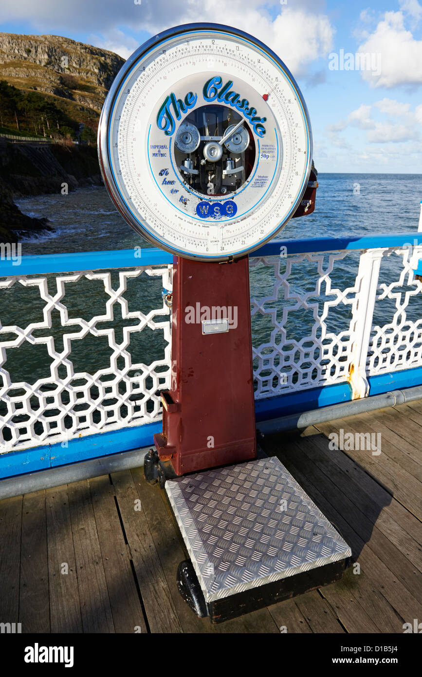 The Classic Coin Operated Weighing Scales On Llandudno Pier Wales UK - Stock Image