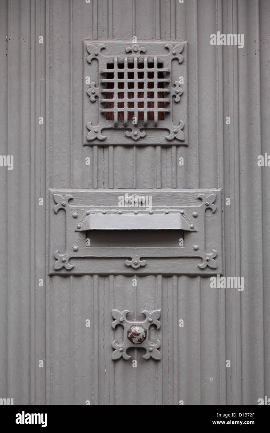 Exceptionnel Gray Door In Bruges, Belgium With Doorbell, Mail Slot And Grate   Stock  Image