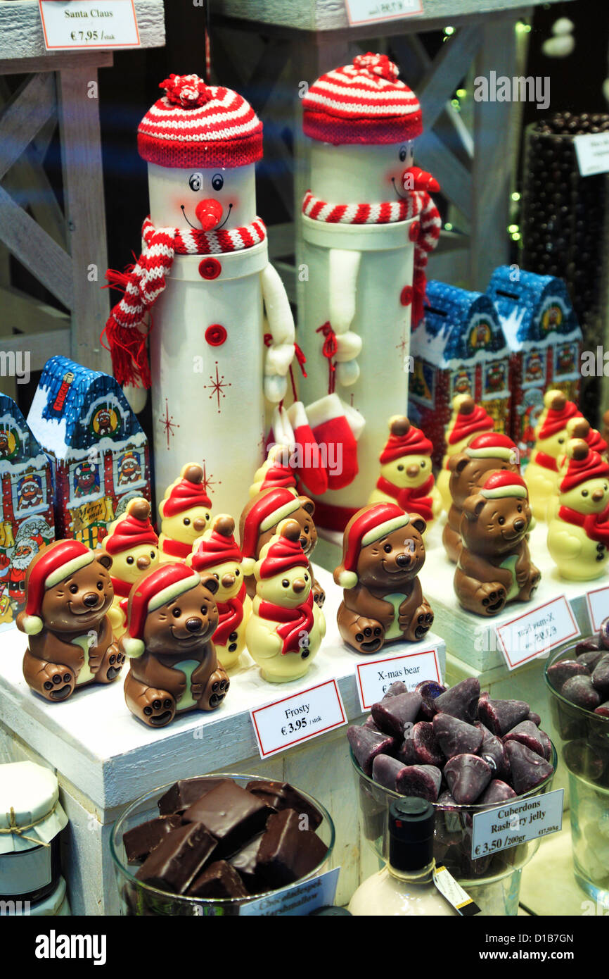 Christmas toys and decorations in a store window display in Bruges, Belgium Stock Photo