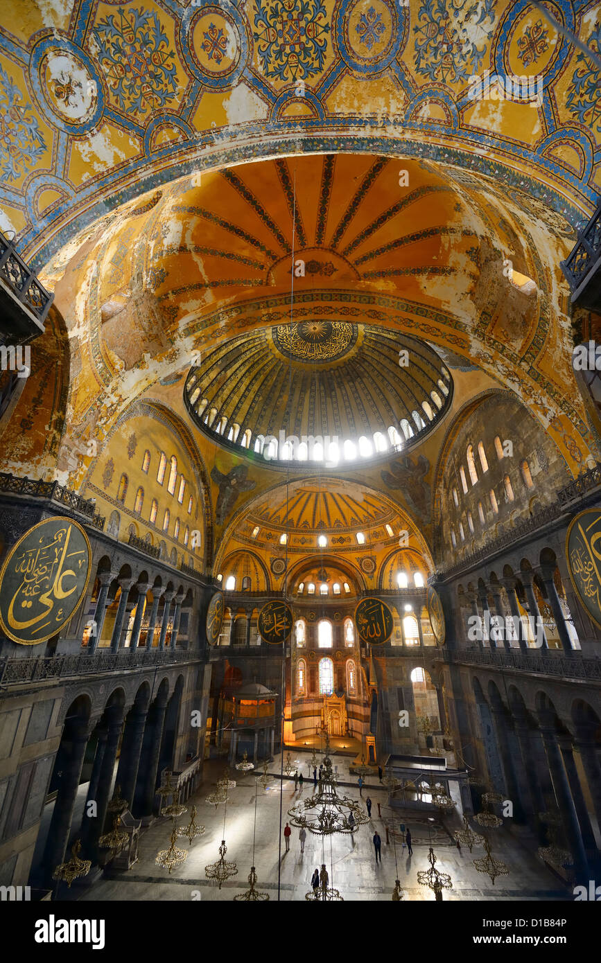 Golden domes frescoes and crooked Qiblah wall inside the Hagia Sophia with wood pendants Istanbul Turkey - Stock Image