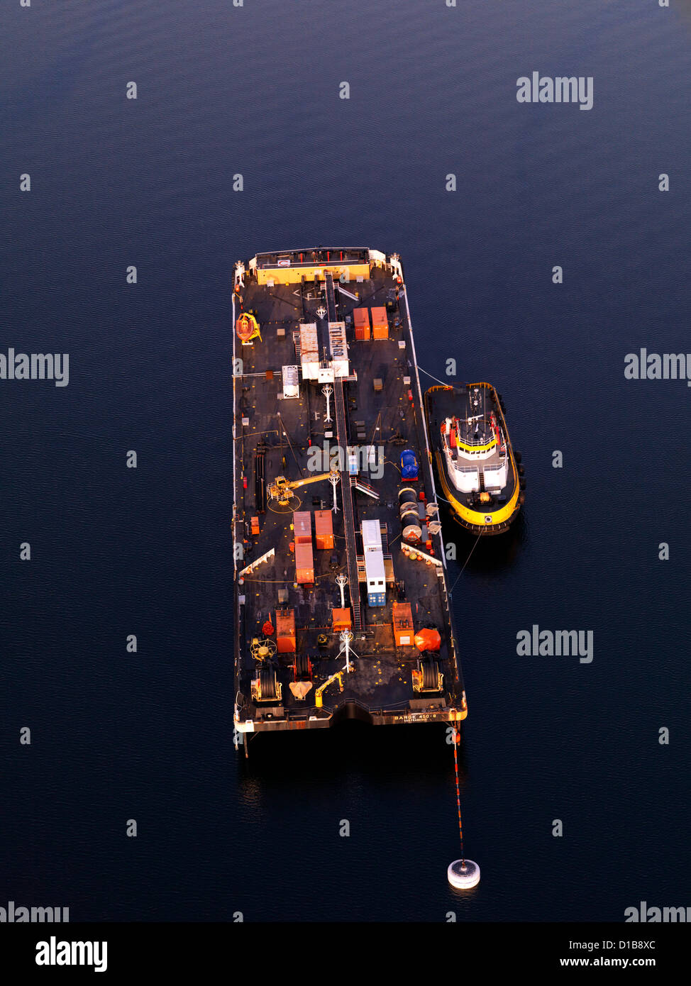 Emergency oil spill recovery barge and tug boat operated by Crawley an aerial photograph Valdez Alaska USA - Stock Image