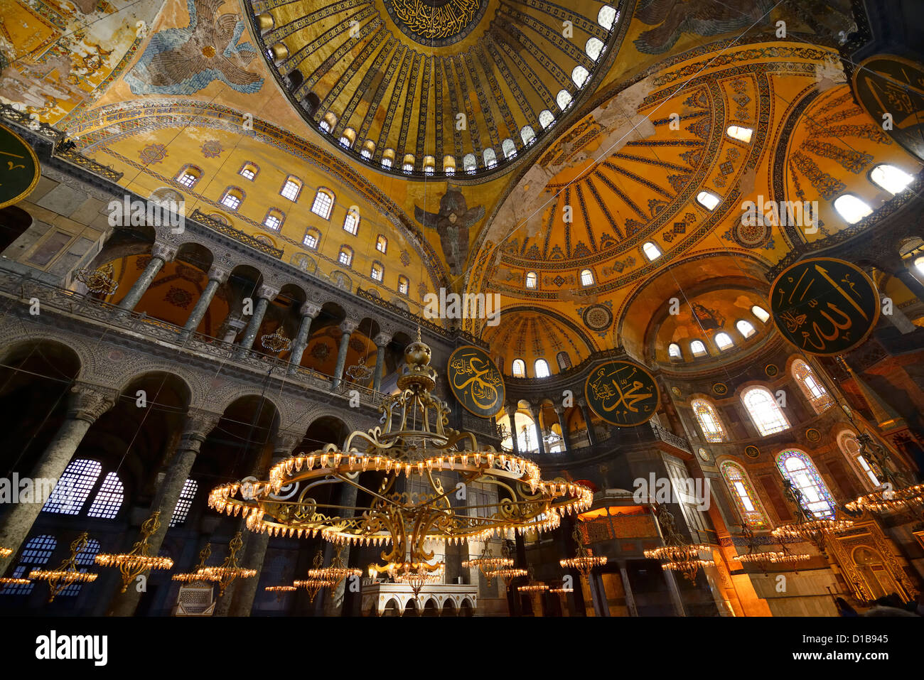 Golden ceiling domes and lit chandeliers in the hagia sophia golden ceiling domes and lit chandeliers in the hagia sophia istanbul turkey aloadofball Images