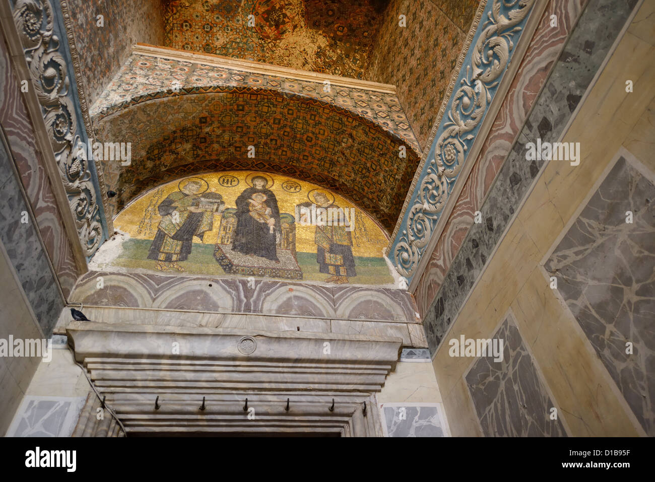 Mary with Christ child and Constantine with city and Justinian with Hagia Sofia at the exit Istanbul Turkey - Stock Image