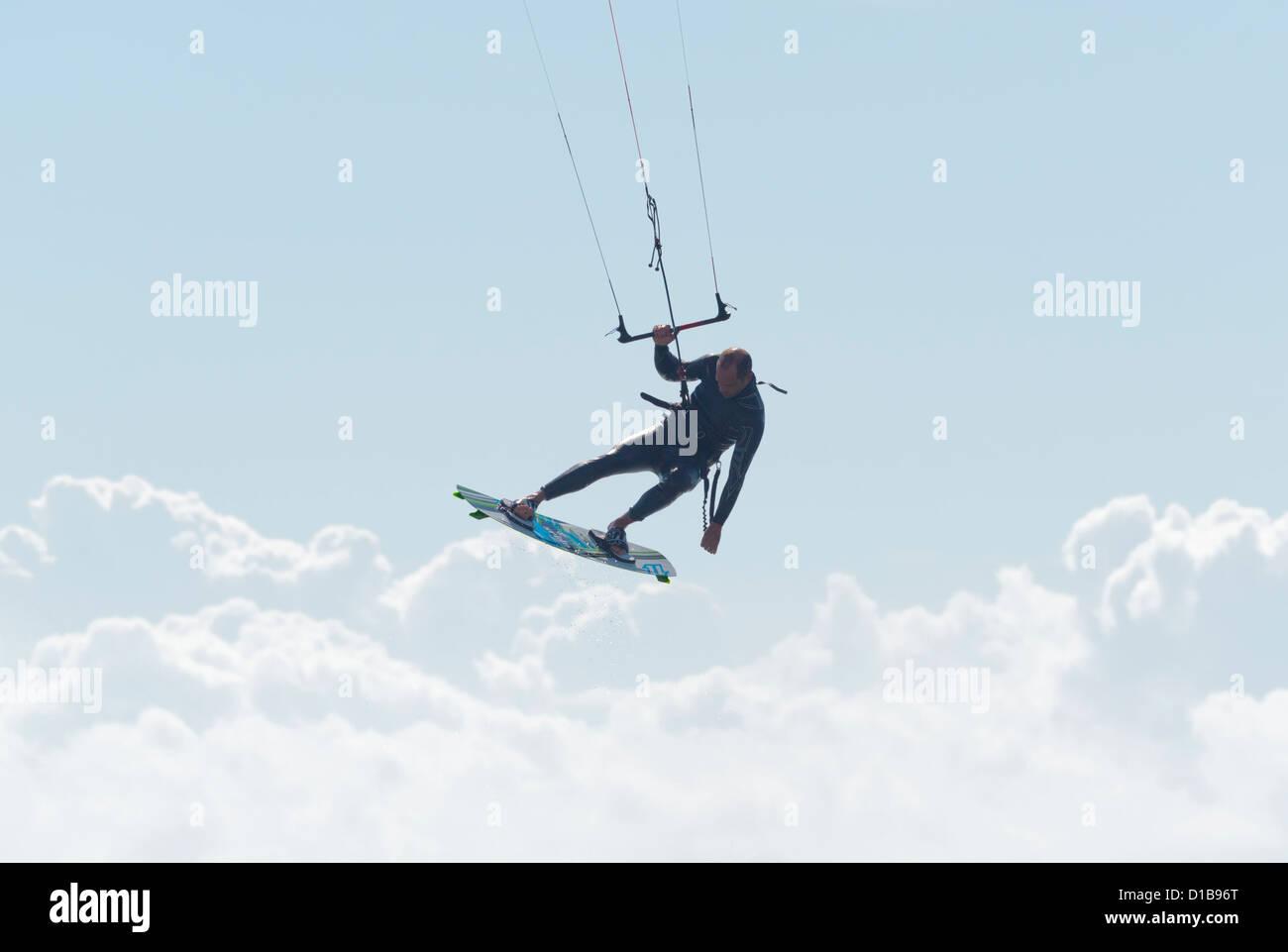 Kitesurfer in big jumpTarifa, Costa de la Luz, Cadiz, Andalusia, Spain. - Stock Image