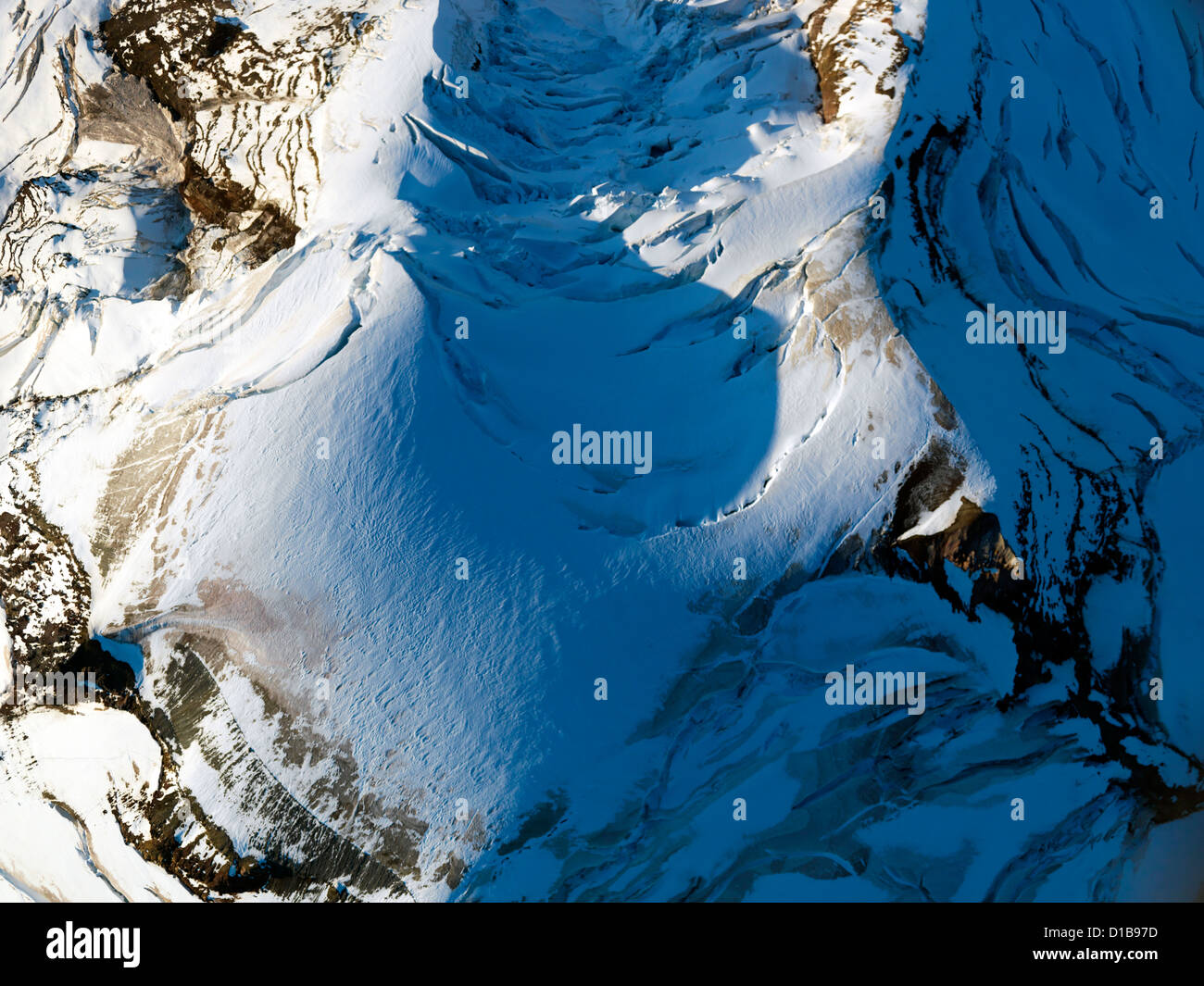 Looking down onto the very top of Mount Baker and the snow covered top of the mountain an aerial photo - Stock Image