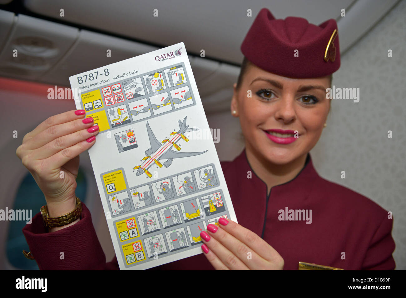 Qatar Dreamliner, Boeing 787, stewardess with Safety instructions for the Dreamliner - Stock Image