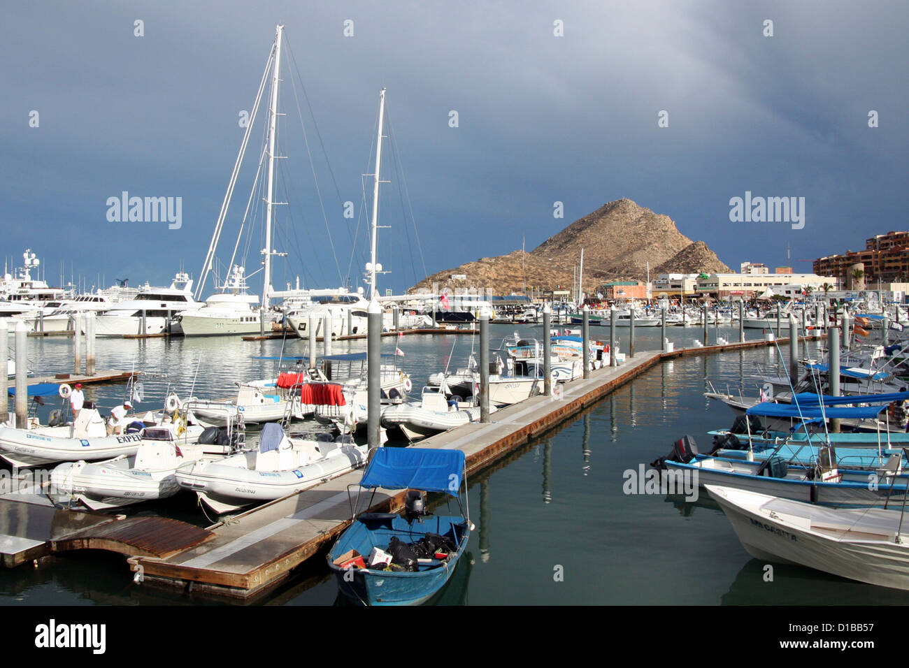 Boats and yachts at Cabo San Lucas Marina on a cloudy day Stock Photo