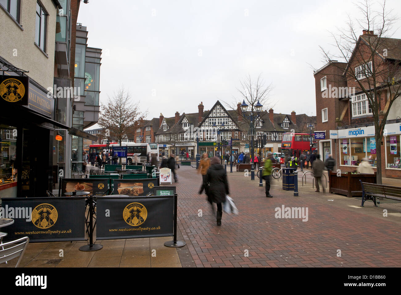 Christmas Shoppers on Solihull High Street outside Touchwood Shopping Centre. - Stock Image