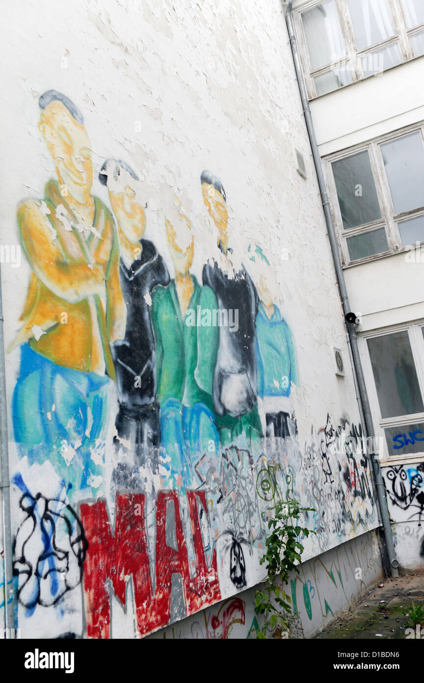 Sangerhausen, Germany, artistic graffiti on the wall of a vacant school - Stock Image