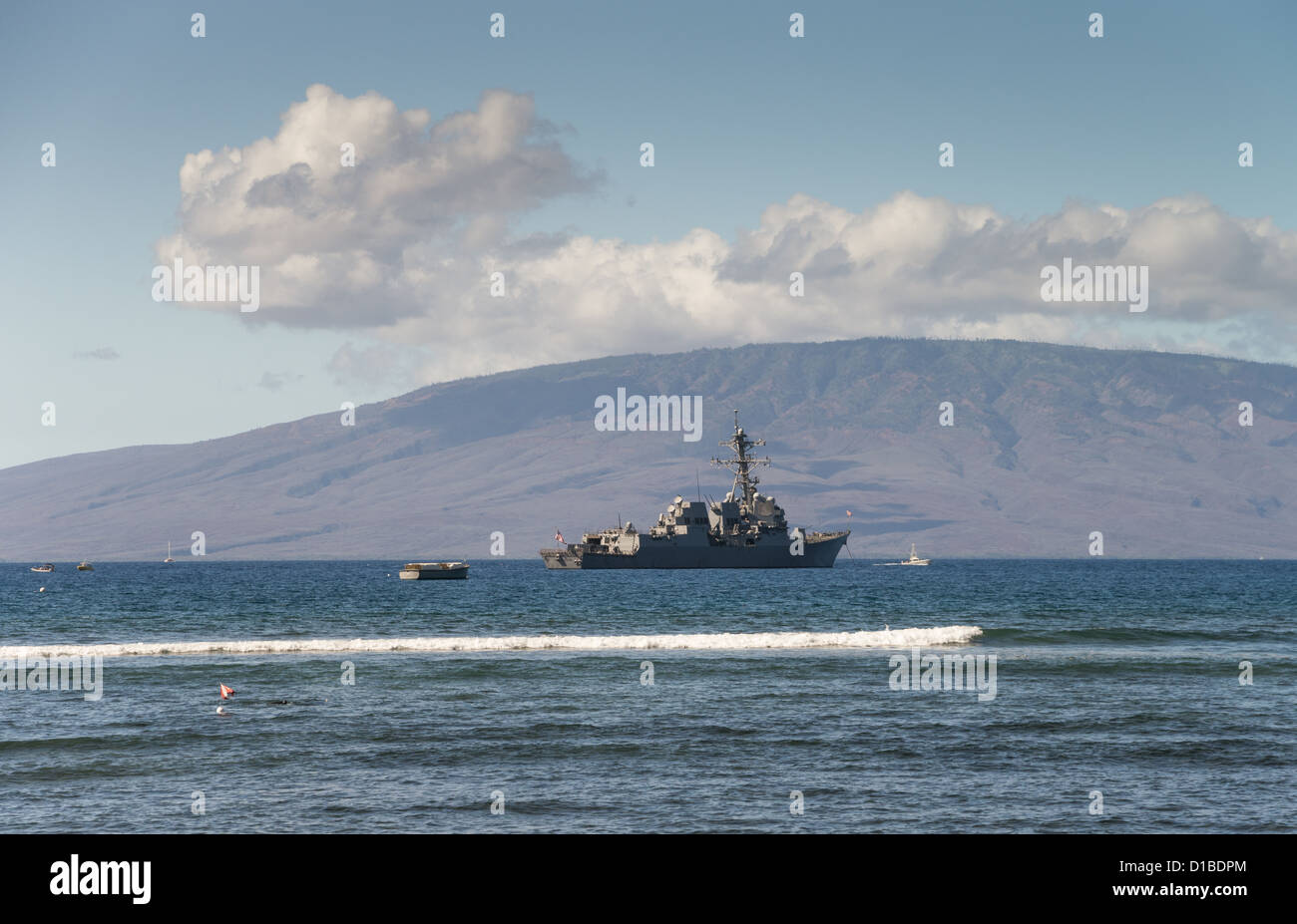 United States Navy Ship anchored off the coast of Maui, Hawaii. The island of Lanai in background Stock Photo