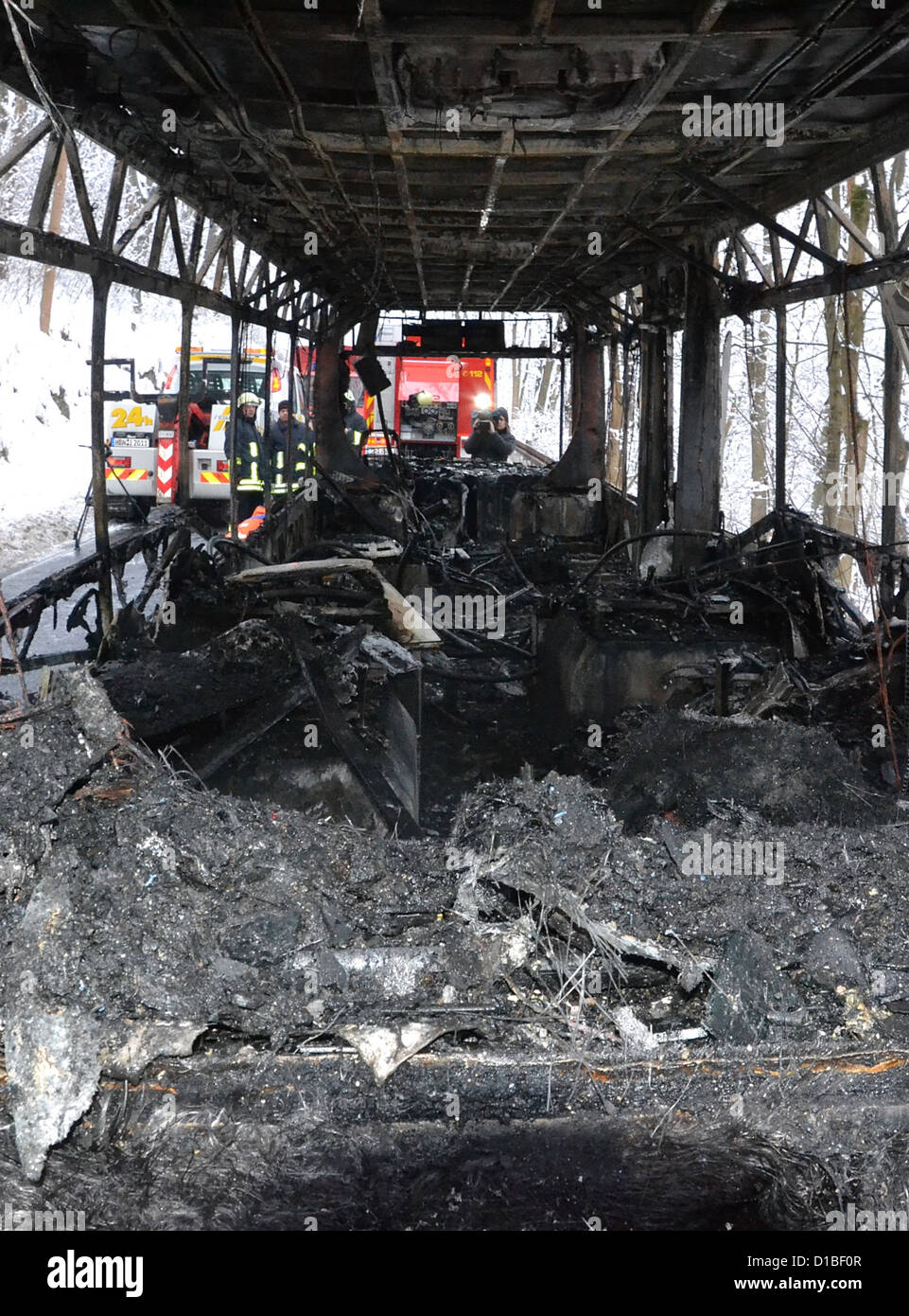 A bus is burnt out completely on a road between Meiningen and Dreissigacker, Germany, 13 december 2012. The bus - Stock Image