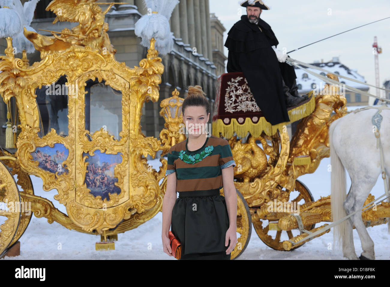 Lead actress Hannah Herzsprung (Elisabeth,Empress of Austria) stands in front of the golden coach from the - Stock Image