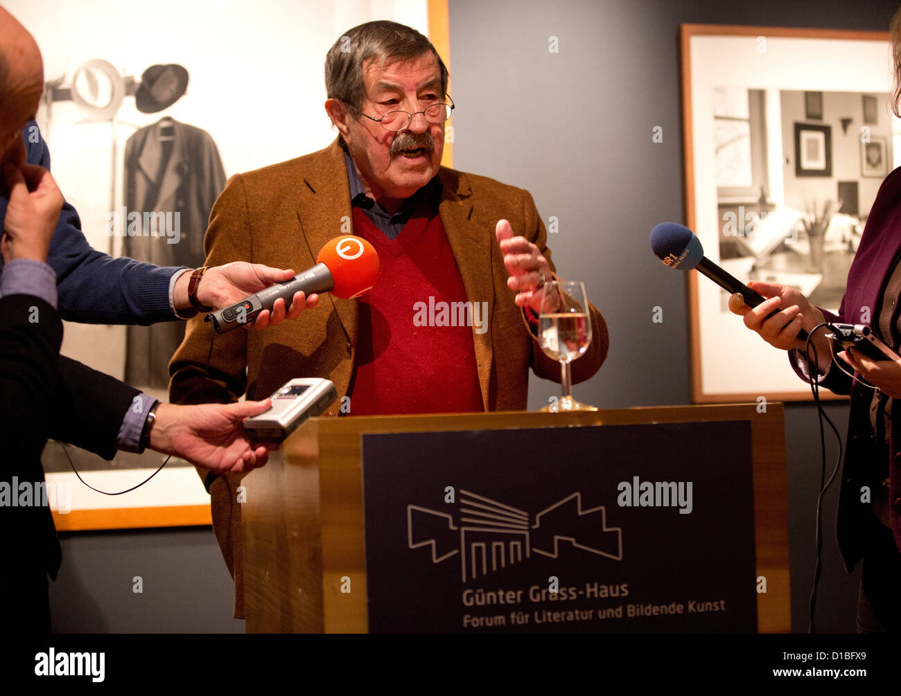 """Nobel Prize laureate in Literature Guenter Grass (R) talks after winning the award""""2012 European of the Year"""" at Stock Photo"""