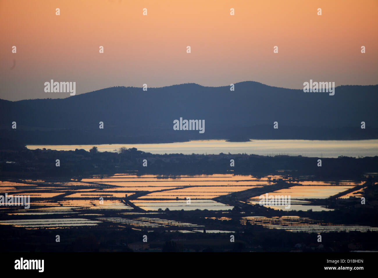 Sunrising above the Porquerolles island and the salt flats - Stock Image