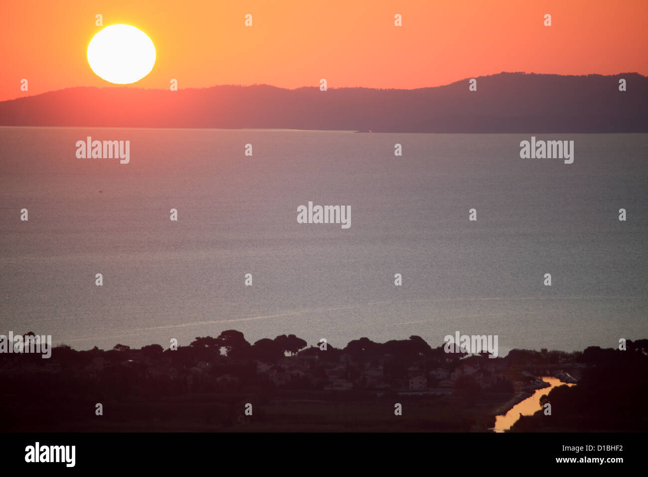 Sunrising above the Porquerolles island - Stock Image