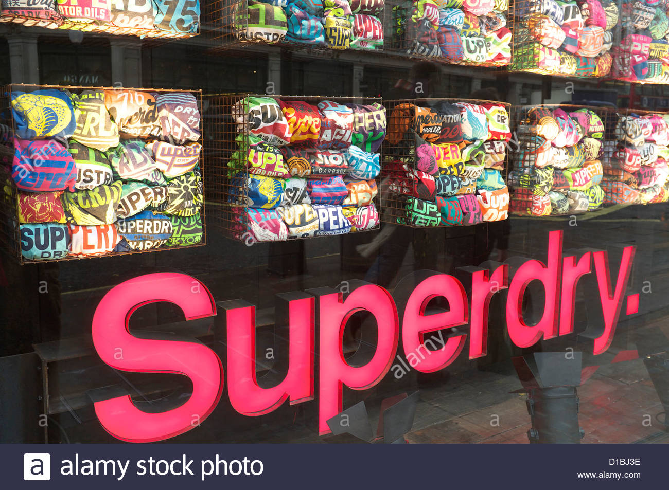 Shop window display of a Superdry clothing store in London, UK. - Stock Image