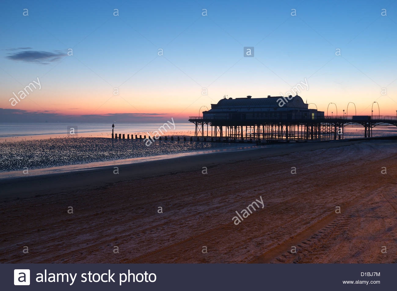 Cleethorpes pier during a frosty morning sunrise, Lincolnshire, UK. - Stock Image