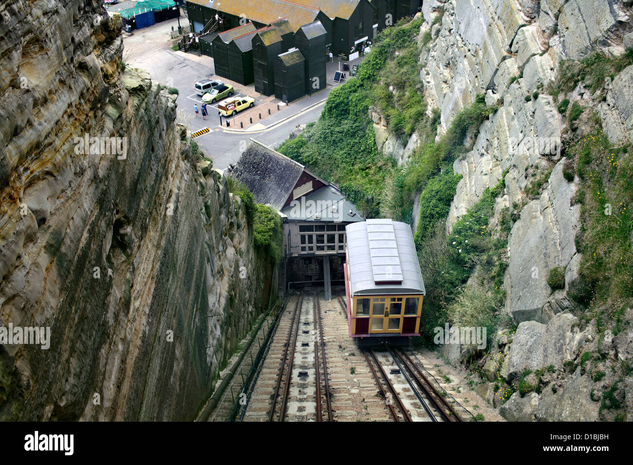 A passenger car ascending the East Cliff Lift, a funicular railway in Hastings - as photographed from the other - Stock Image