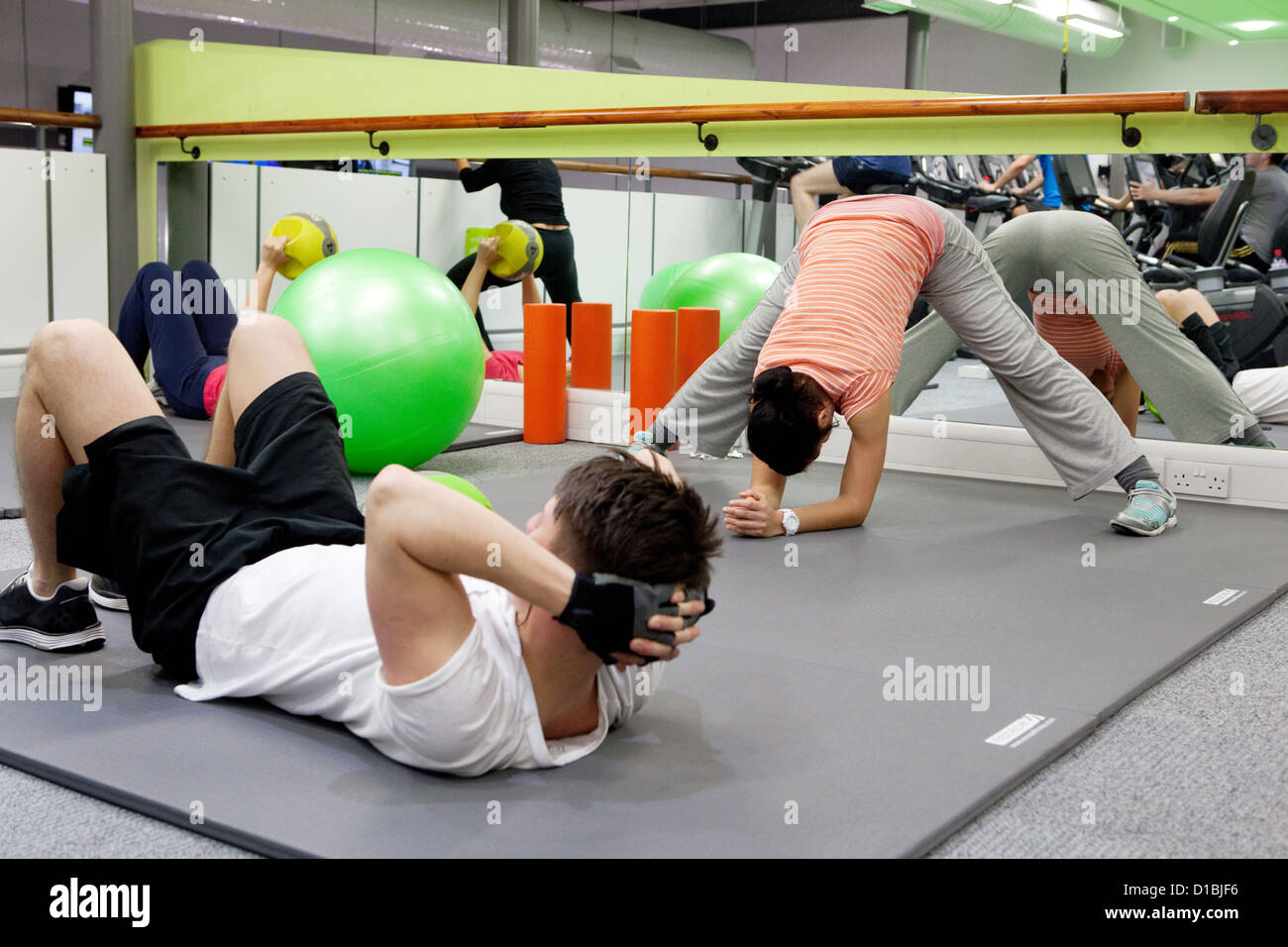 Physical exercising in a gym - Stock Image
