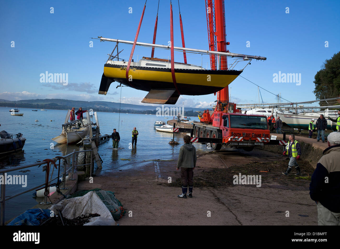 Lifting boats out of the water for winter maintenance, Lympstone, Exe Estuary, Devon, UK - Stock Image