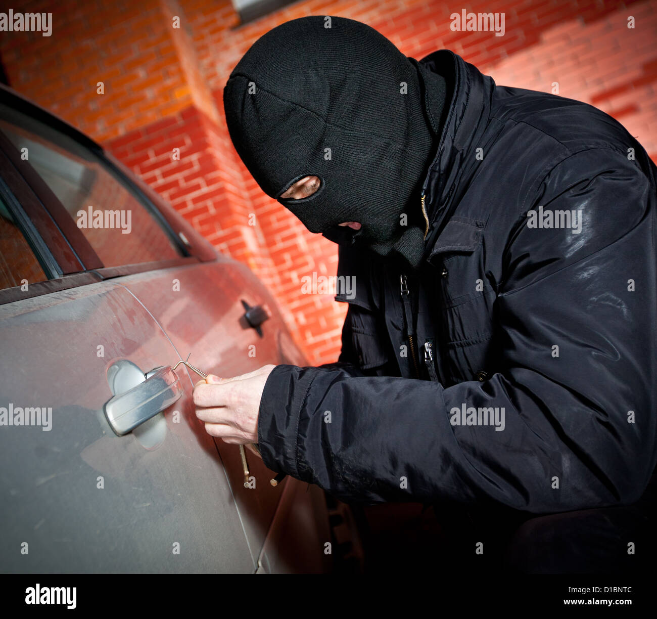 robber and the thief hijacks the car - Stock Image