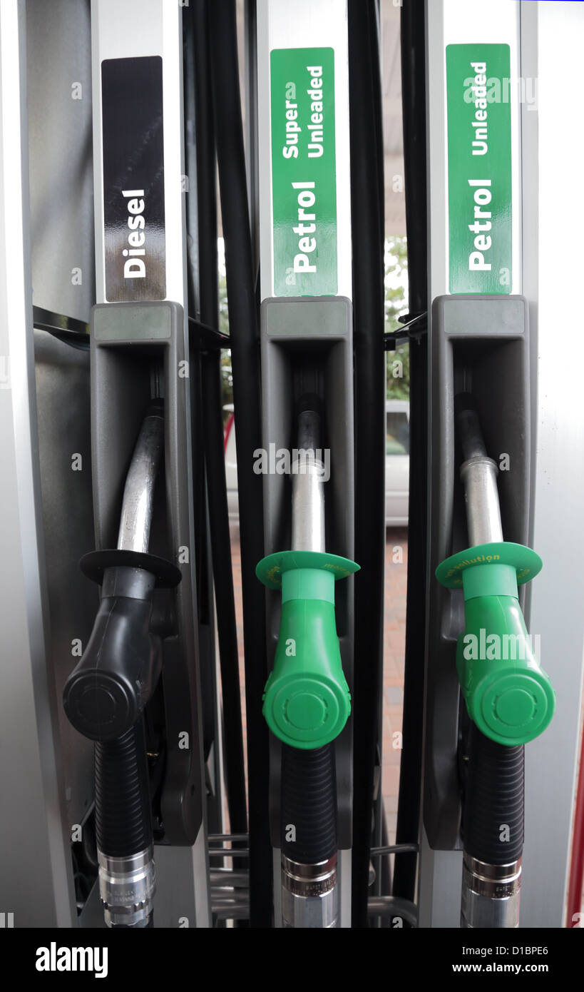 Diesel and petrol pump nozzles at a service station Stock