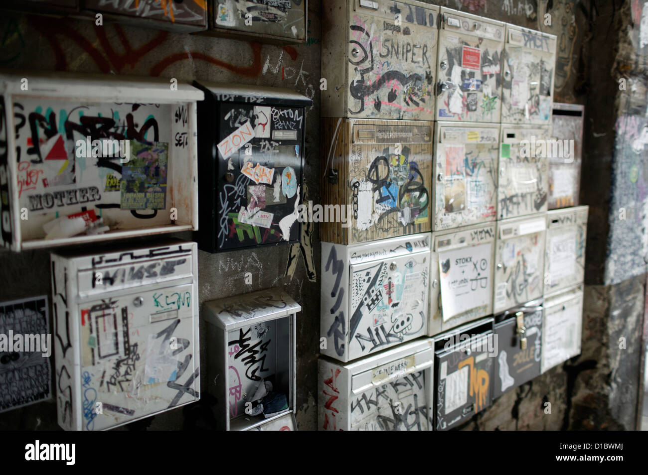 Berlin, Germany, mail boxes with graffiti and stickers at the Haus Schwarzenberg Stock Photo