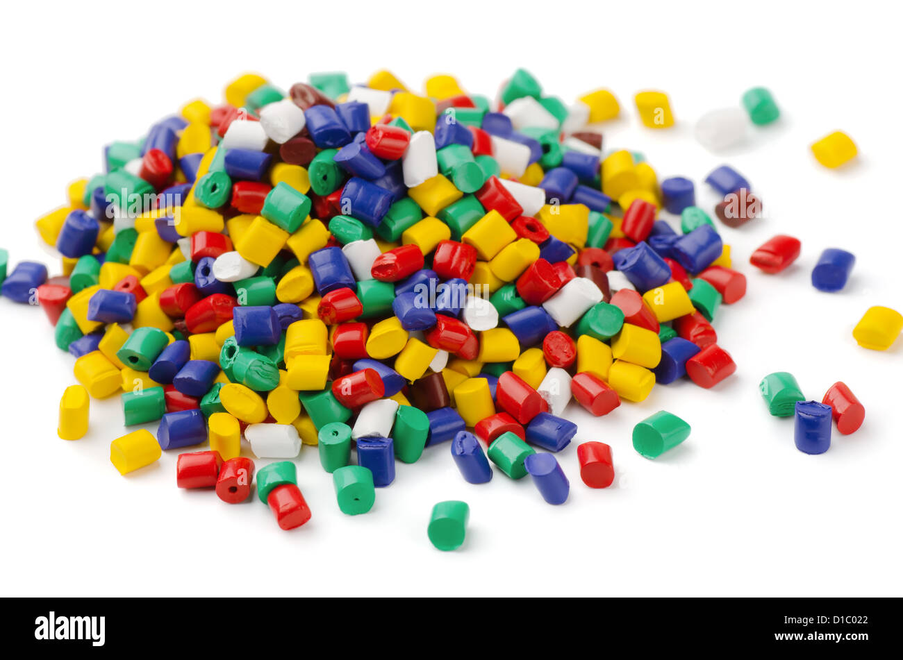 Pile of colorful plastic polymer granules isolated on white - Stock Image