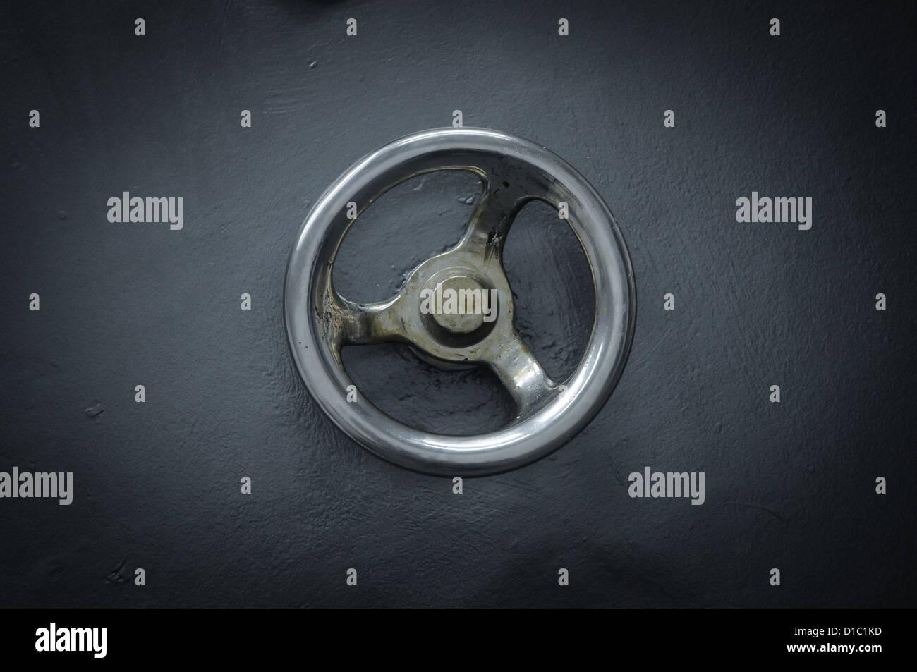 old bank vault door - Stock Image