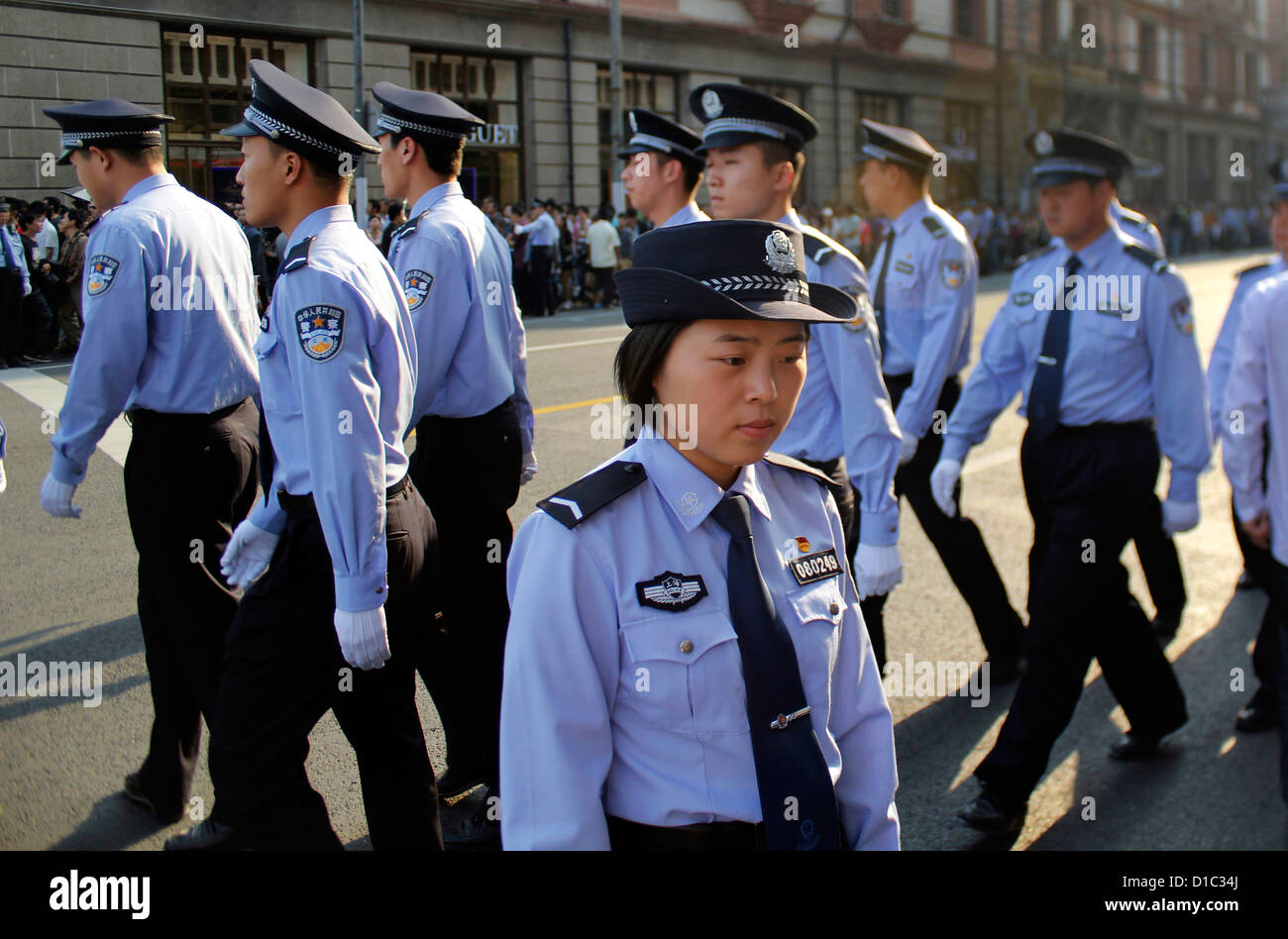 Chinese Police Officers Patrolling The Streets Of Shanghai During International Day China Stock