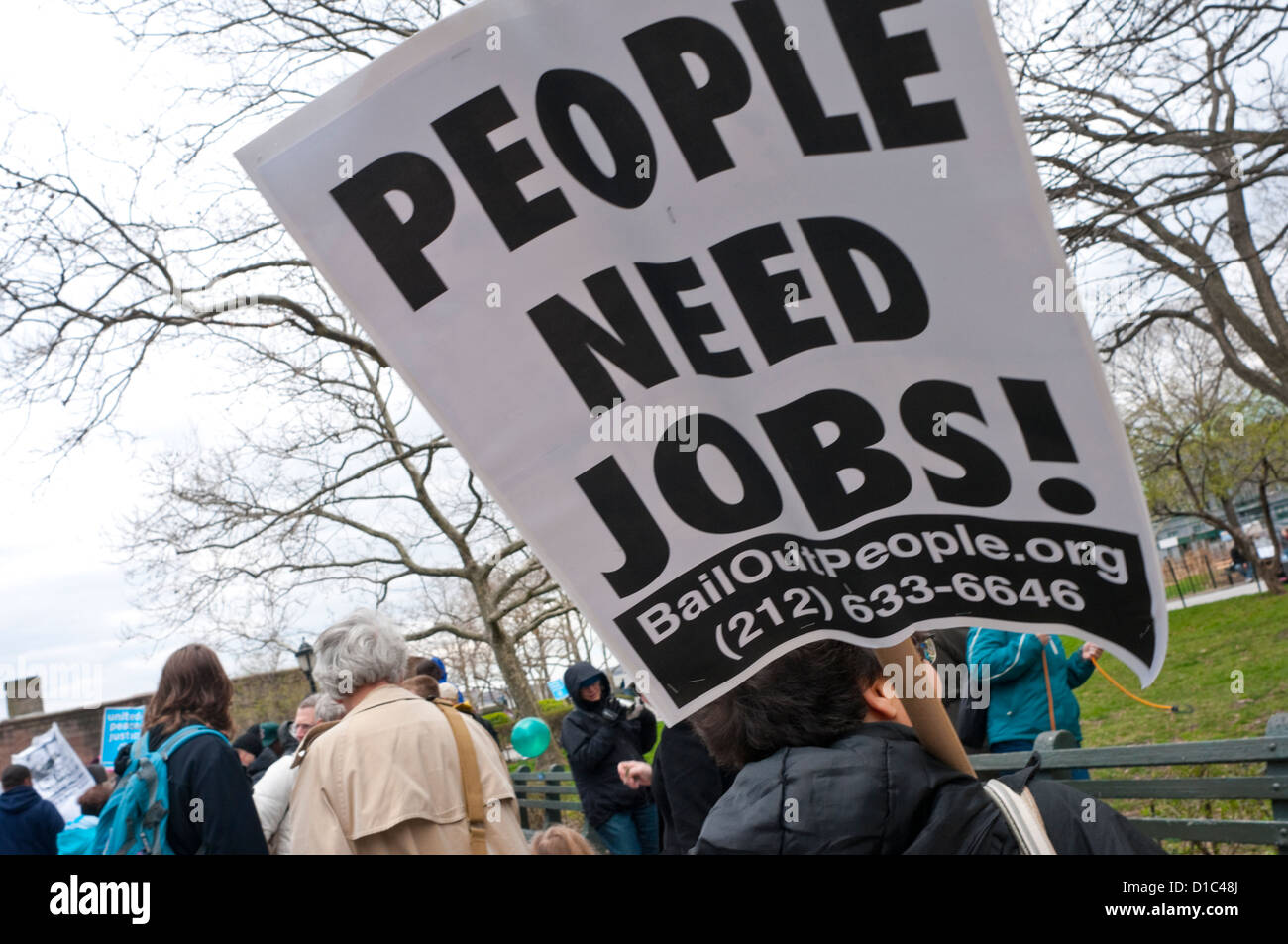 Anti corporate bail out protesters march down Broadway to Battery Park - Stock Image