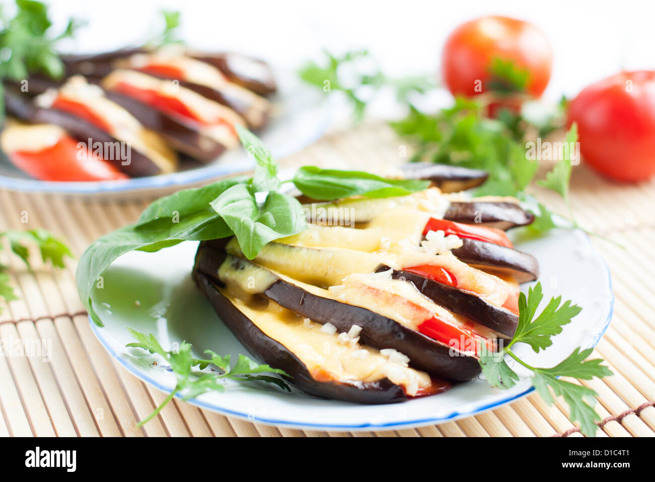 Eggplant with cheese and garlic sauce and fresh herbs, close-up Stock Photo