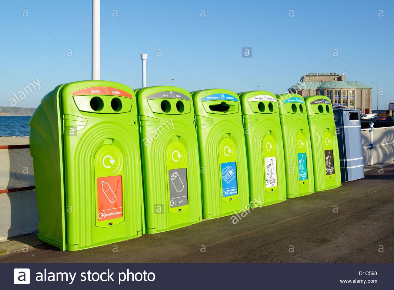 Separate materials Recycling bins, seafront, Weymouth, Dorset England Stock Photo
