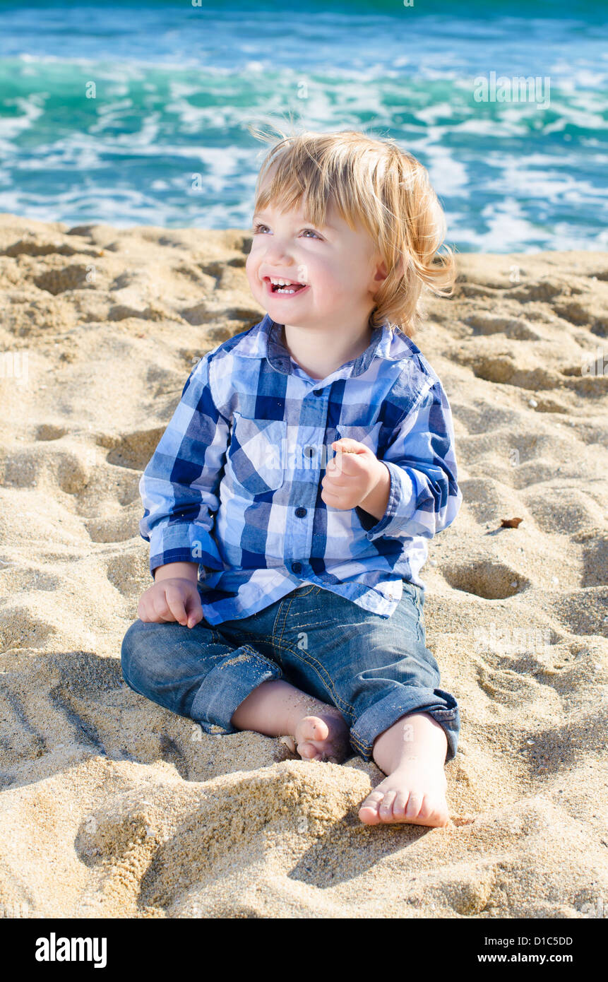 A nice boy smiling on a beach - Stock Image