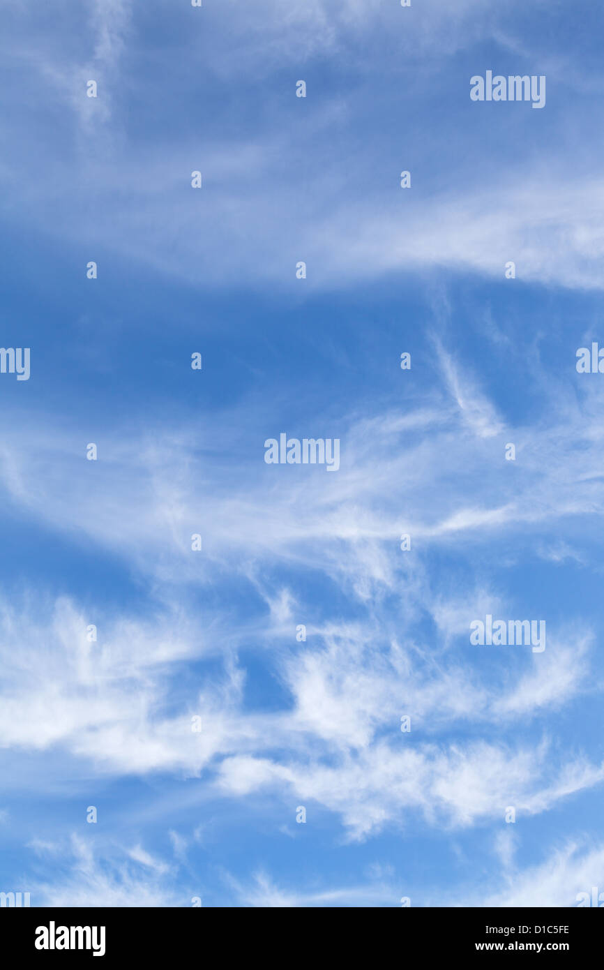 swirling small white clouds in italian blue sky in autumn - Stock Image