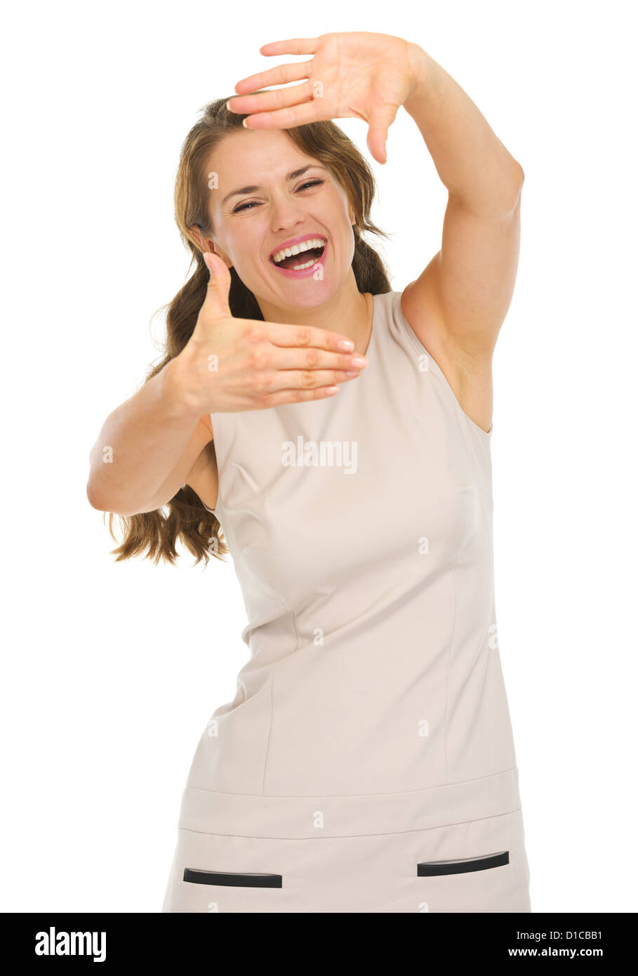Happy young woman in dress framing with hands - Stock Image