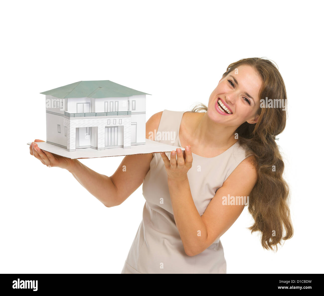 Smiling woman landlord with scale model of house - Stock Image
