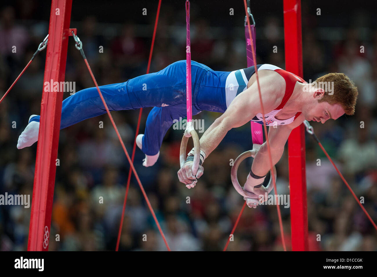 Daniel Purvis (GBR) competing on the rings during the Men's Individual All-Around at the 2012 Olympic Summer - Stock Image