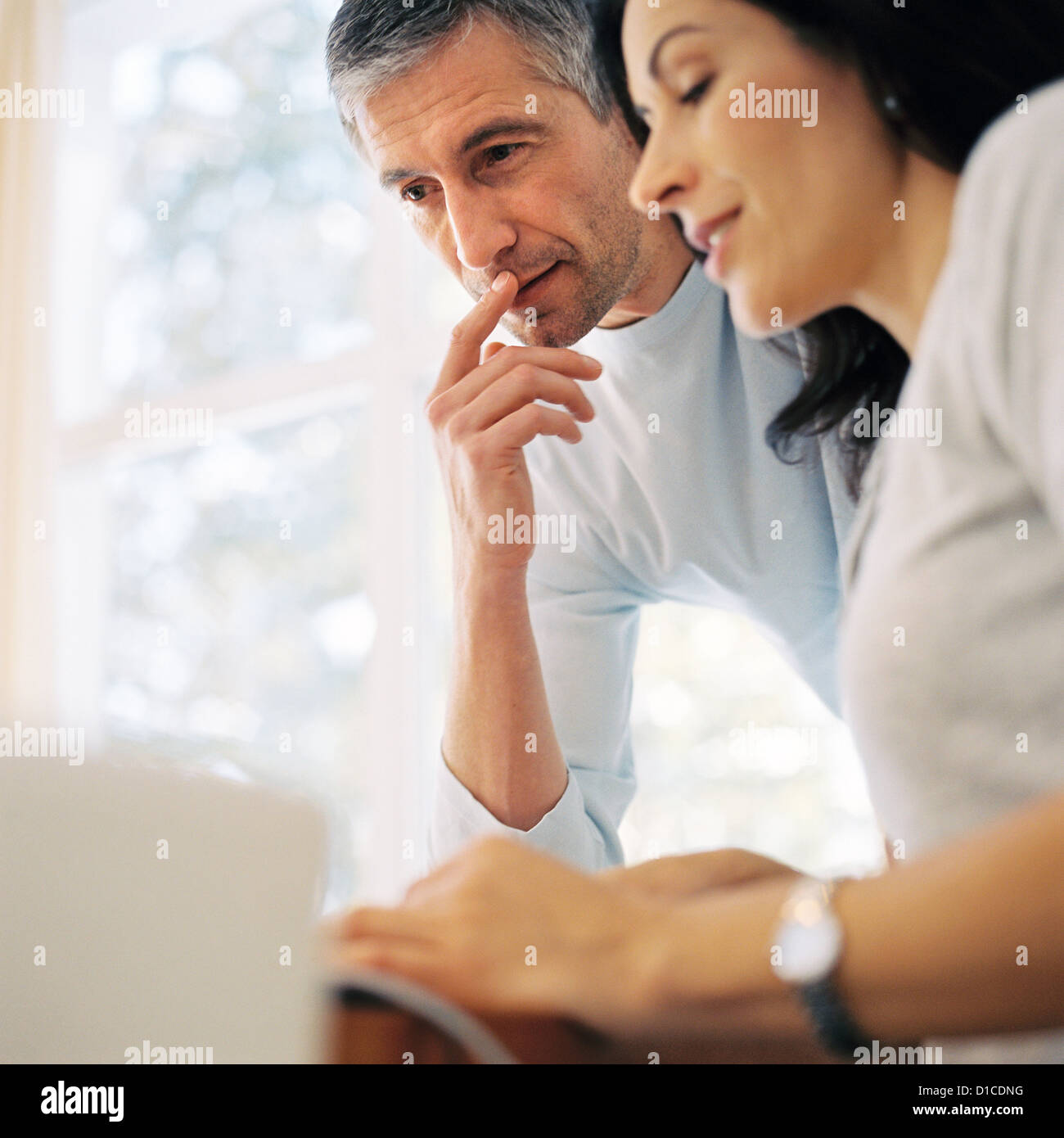 Man and woman at home License free except ads and billboards - Stock Image