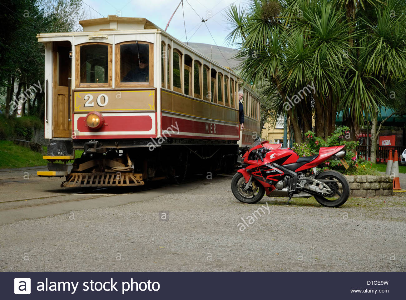 train of the Manx Electric Railway and a sports motorcycle in Laxey on the Isle of Man - Stock Image