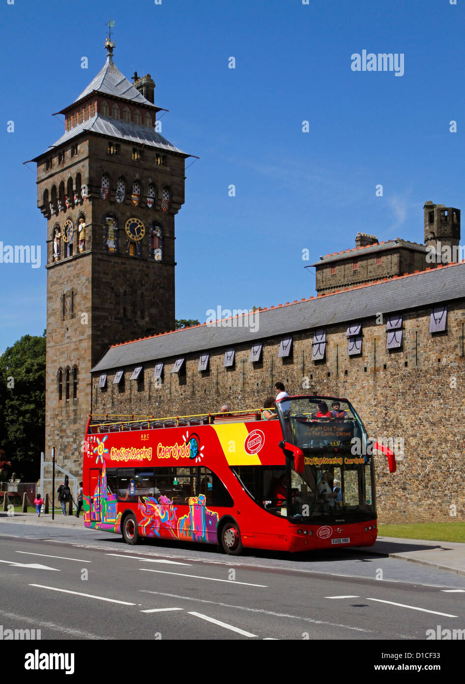 Tourist sightseeing bus outside Cardiff Castle, Cardiff, Wales, UK - Stock Image