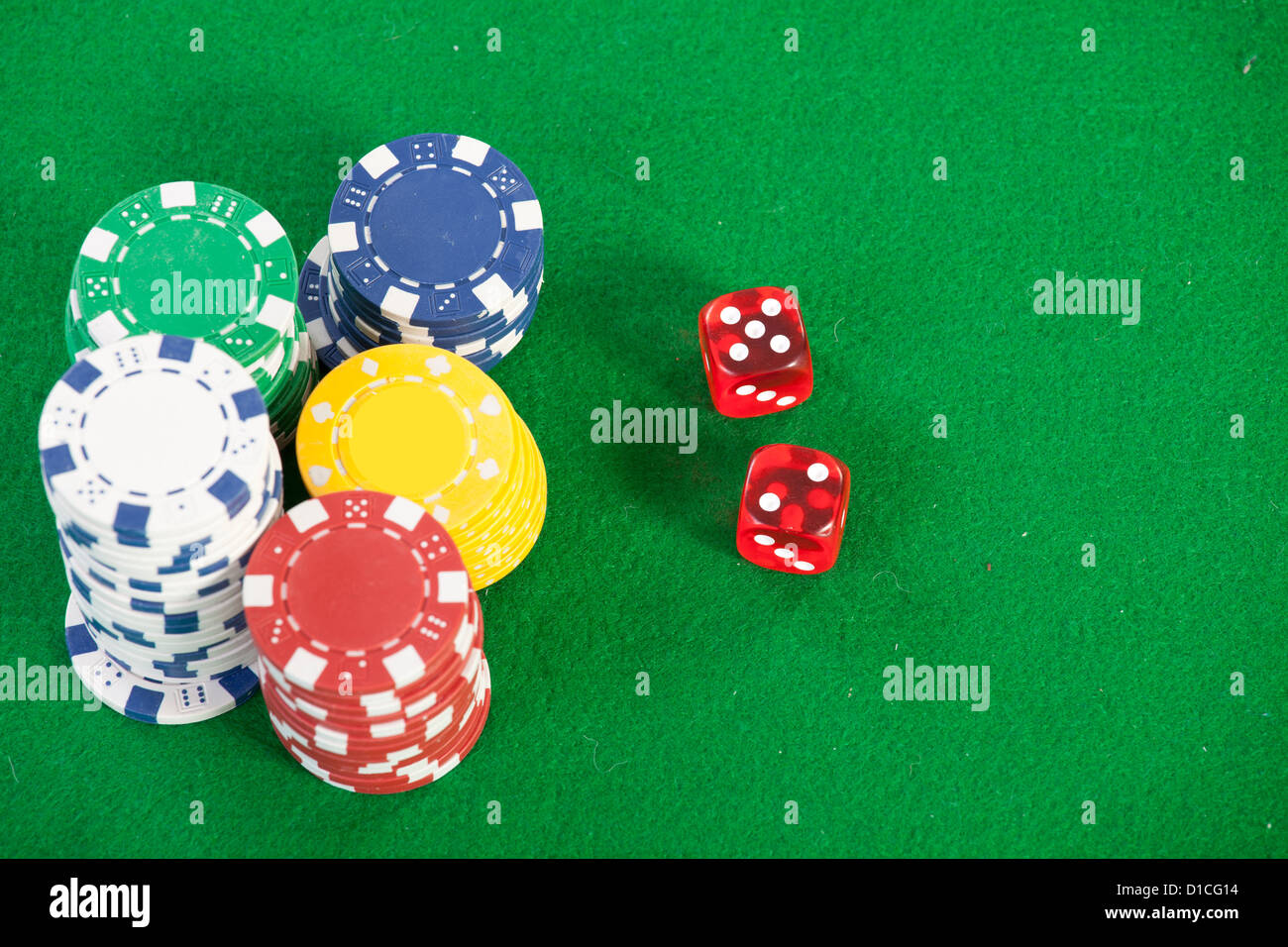 red dice on a casino table with chips - Stock Image