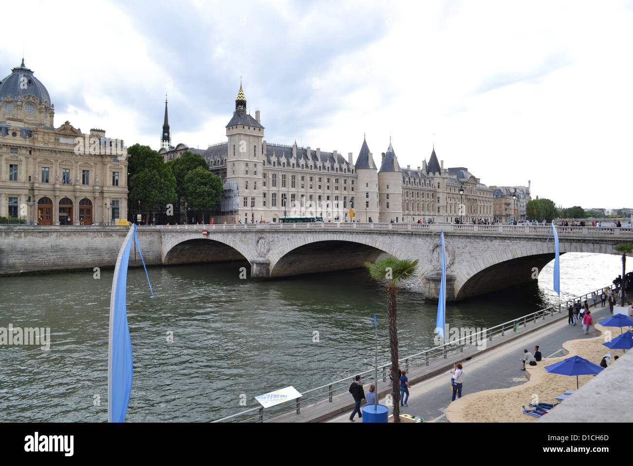 La Conciergerie palace and prison in Paris viewed from across the Seine. - Stock Image